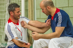 Ian Johns, Head Paralympic Coach, works with Sam Ingram between fights at GB VI Grand Prix